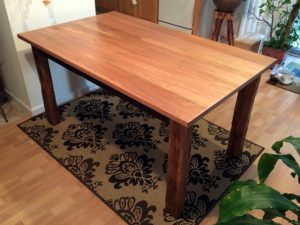 Dining table with Red Bay top recovered barn wood base Evan Wittels