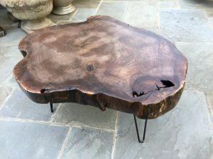 Walnut wood slice coffee table metal pin legs Evan Wittels
