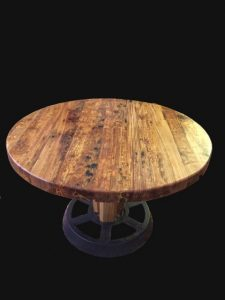 River-recovered Heart Pine coffee table with metal pulley base Evan Wittels salvaged metal